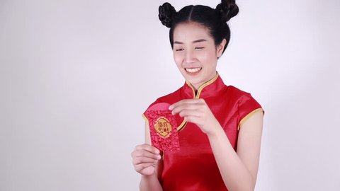 woman wear cheongsam and open red envelope in concept of happy chinese new year