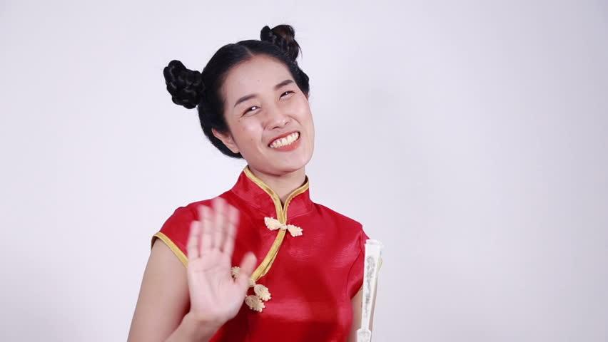 happy woman wear cheongsam and saying goobye
