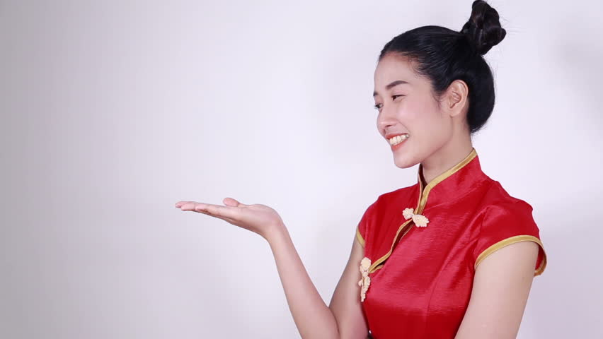 woman wear red cheongsam with open hand palm in concept of happy chinese new year