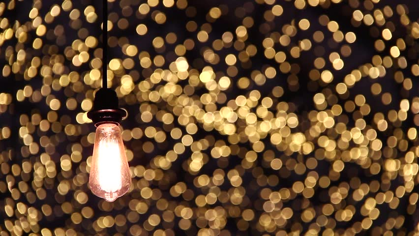 Light Bulb On Beautiful Bokeh Background. Focus/Blur | Shutterstock HD Video #1007371129