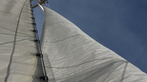 The Crew of Sailing Tall Ship is Working on Deck with White Sails