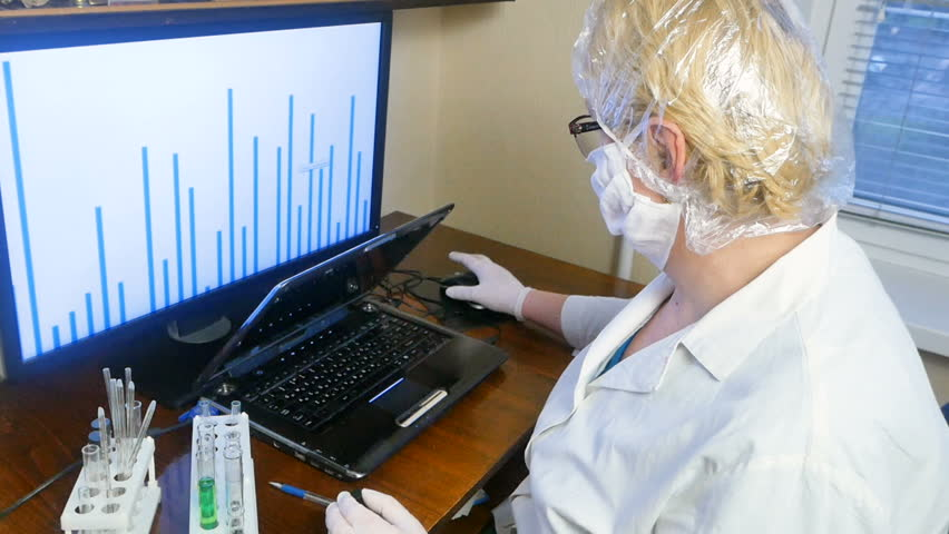 Medical worker with tests in tubes is working in computer to medical analysis | Shutterstock HD Video #1007405959