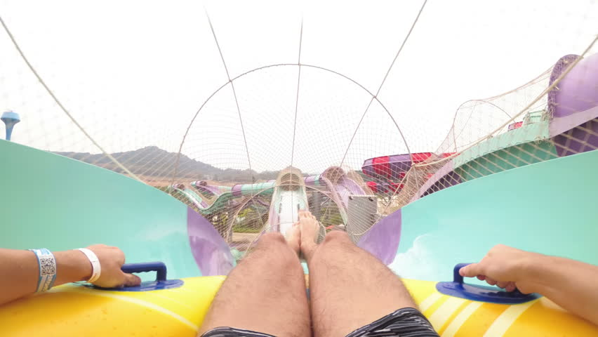Water slides pov. Man on inflatable ring goes down with water slides. First-person view. Aqua Park of the Ramayana. Thailand. Chest Mount.