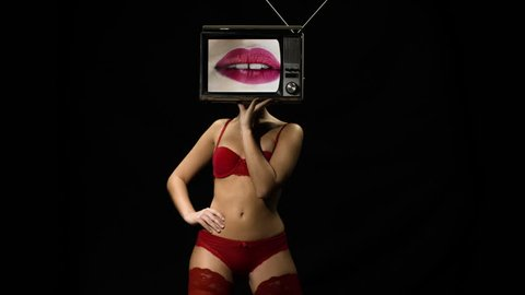 amazing woman in red lingerie dancing and posing with a television as a head. the tv is has video of lips moving