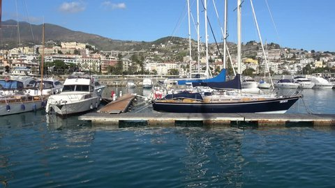 Sailing yachts and boats docking in yacht marina in Italy