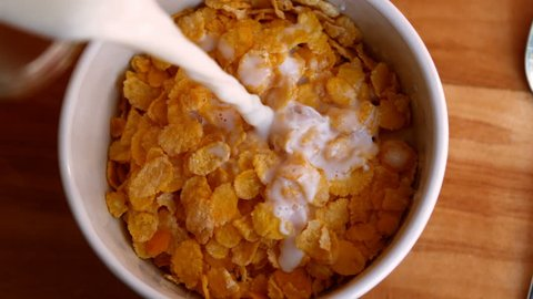 Close-up of milk being poured in cornflakes