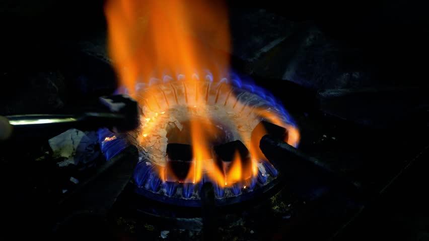 Preparation of a shisha hookah from grapefruit - roasting hookah coals on fire