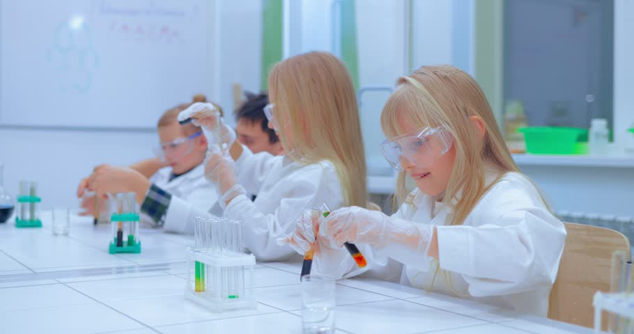 Teacher and students doing science experiment in school classroom. Children in chemistry class | Shutterstock HD Video #1007553403