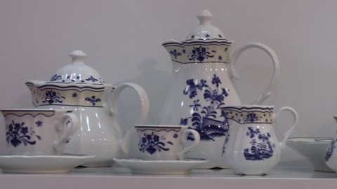 Teacups and teapots with blue floral patterns, elegant fine porcelain at china exhibition
