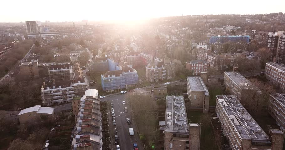 Aerial drone footage of residential buildings in the North of London, England: Finsbury Park/Crouch Hill area.  Sun is low on the horizon.