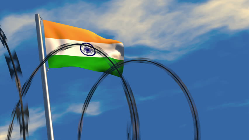 3D animation of a Indian flag waving on a flagpole as razor wire appears in the foreground; depicting the increase of barriers between nations. | Shutterstock HD Video #1007618869