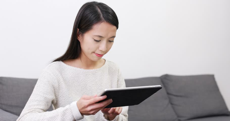 Woman read on tablet computer | Shutterstock HD Video #1007628313