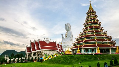 Chiang Rai, Thailand. Wat Huai Pla Kung Temple at sunset in Chinag Rai, Thailand. Illuminated Buddha statue and temple with cloudy blue sky. Time-lapse at sunset