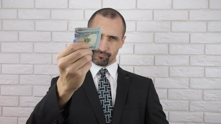 Business man gives money. | Shutterstock HD Video #1007654779