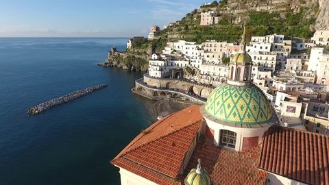 Aerial drone footage view of The Amalfi Coast is the stretch of coast bell, south of the Sorrento Peninsula, overlooking the Gulf of Salerno, Italy in the Mediterranean Sea // no video editing