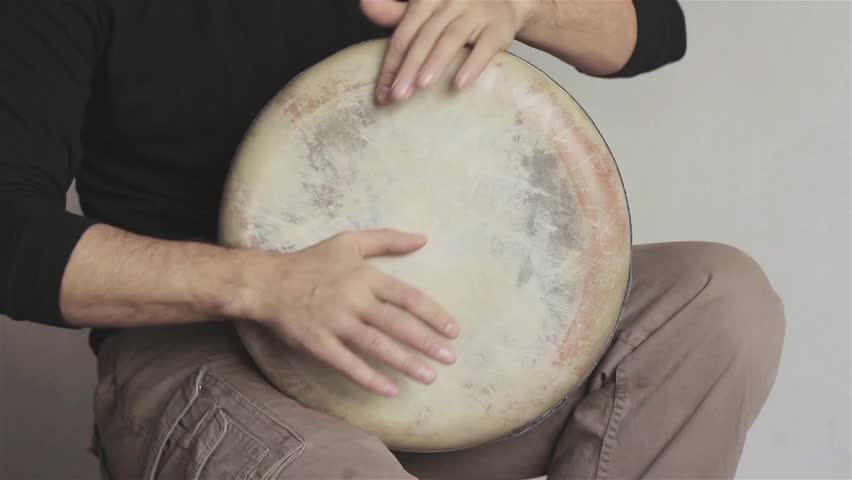 Man plays ethnic drum darbuka close up. Male hands tapping djembe bongo hands movement rhythm. Musical instruments world culture sound