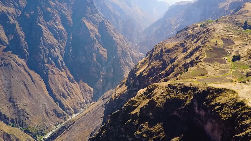Drone aerial flying sideways over the massive Colca Canyon valley in Peru