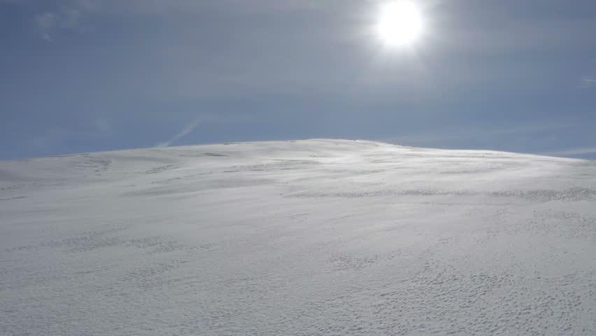 A hiker climbs the snow-covered hill | Shutterstock HD Video #1007712829