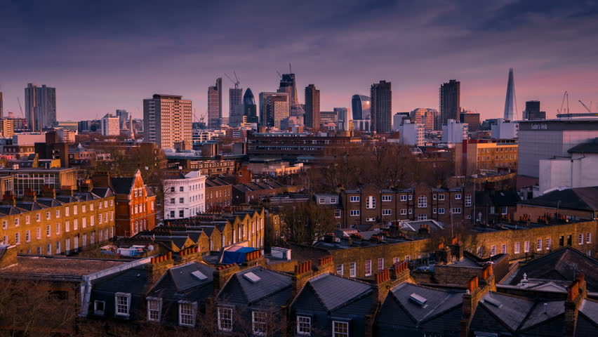 Wide angle day to night timelapse of the London City skyline, the financial heart of London, England, UK, including the Shard, the Gherkin and contrasting Victorian houses in the foreground | Shutterstock HD Video #1007732269
