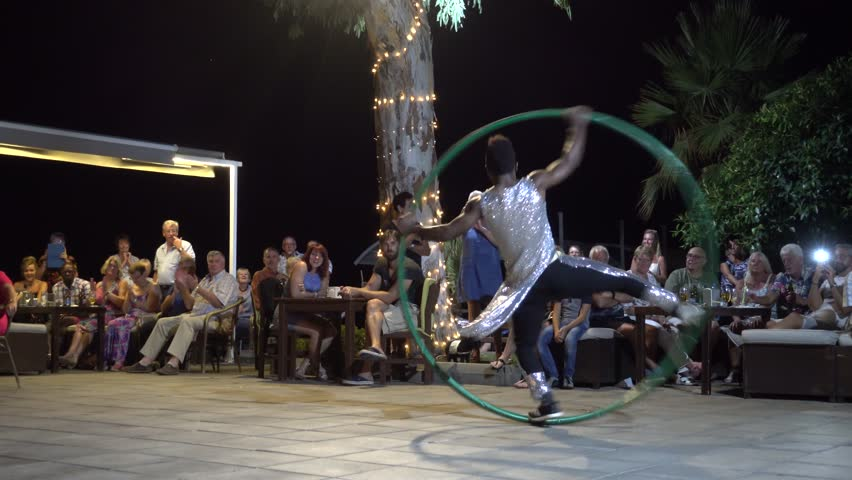Fethiye, Turkey - 15th of September 2017: Show program at the Aroma Beach - 4K Audience applauses to the black performer with hula hoop audio