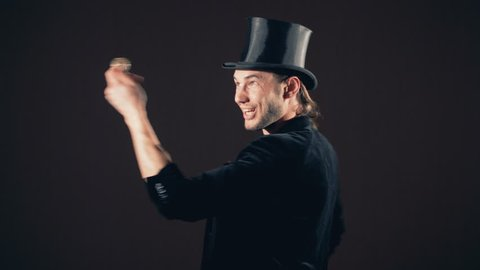 Magician advertising something. Illusinist show with his finger on an empty place for your text.