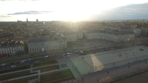 Drone view of the city of Bordeaux in France well known for its wine culture : the place de la bourse, the water mirror, the Garonne river and the chamber of commerce and industry. Bordeaux vu du ciel