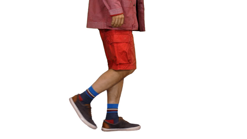 Side view of male tourist walking in red jacket and shorts, Full HD footage with alpha channel