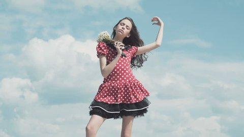 Nice girl. Blue sky. Dreaming. Girl posing. lovely girl enjoys beautifule spring day.