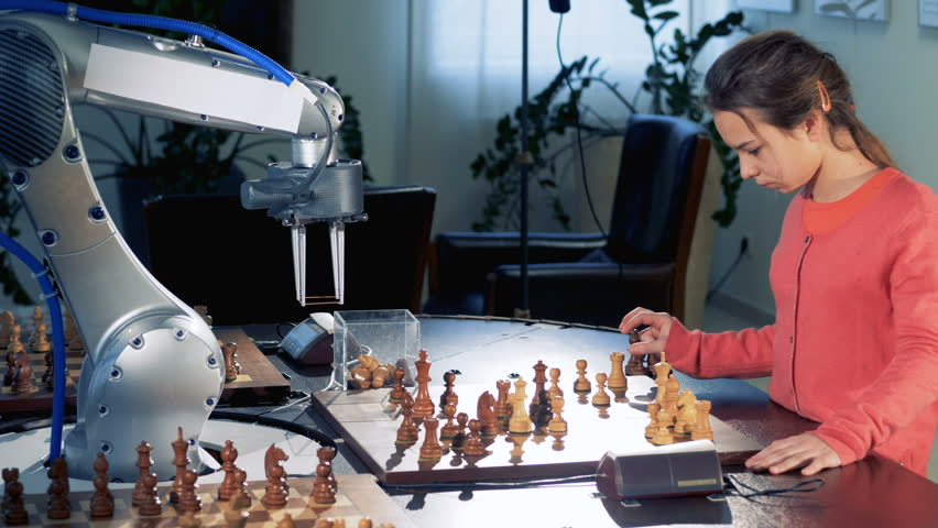 Young girl moves chess figure playing with a modern automated chess robot. 4K.