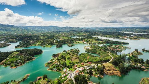 Medellin, Colombia, time lapse view of Guatape from the Rock (La Piedra del Penol) during daytime. Zoom in.