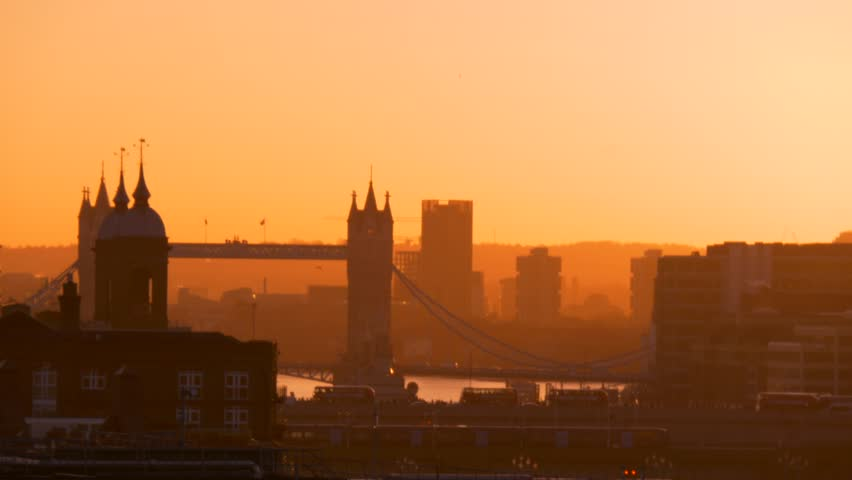 Orange haze of a sunrise over London Bridge