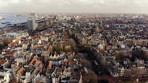 AMSTERDAM, NETHERLANDS February 18, 2018: Amsterdam from above in an aerial shot on a sunny day. The camera flies slowly back.