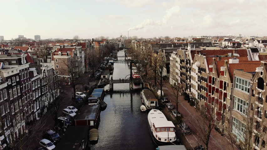 AMSTERDAM, NETHERLANDS February 18, 2018: The Brouwersgracht in Amsterdam at sunset. The camera moves slowly backward. | Shutterstock HD Video #1007832469