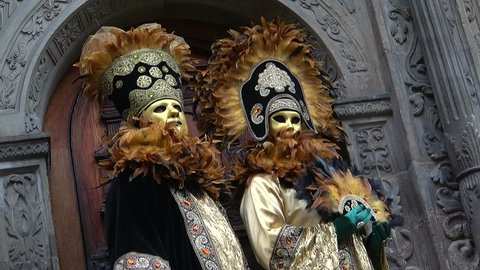 Portrait of an unidentified participants dressed up in venetian style renaissance costume and mask  at the annual festival Hallia Venezia carnival event
