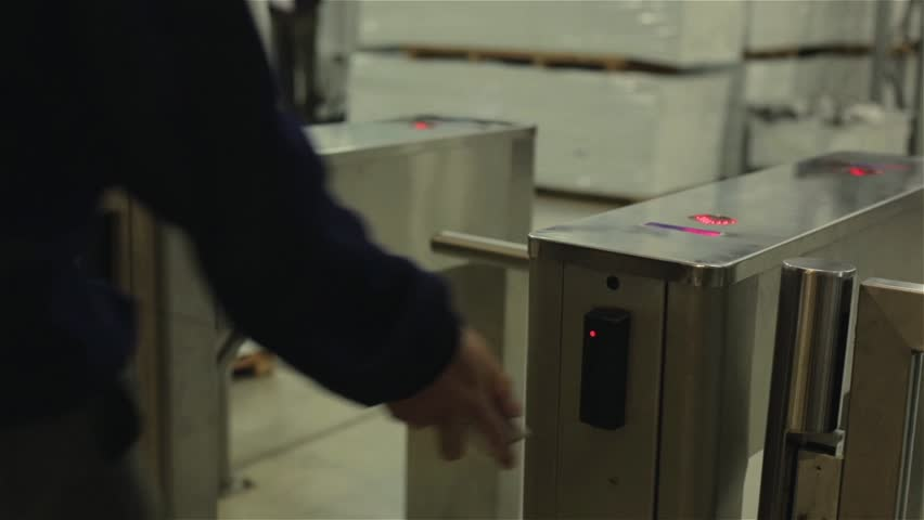 Man Passing through a Turnstile with Electronic Access Card.