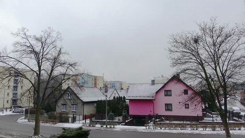 Time Lapse of Squall with  Snow Over Houses and trees