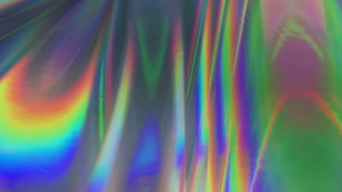 Holographic VJ background. Neon holographic Iridescent foil. Vibrant surface and shiny background with waves.