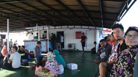 Banda Aceh, Indonesia - 08 25 2017: Local men and women sitting on the ferry