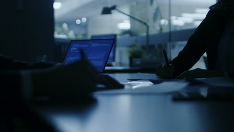 In the Dark Late Night Office Close-up on Hands of Businesswoman and Businessman while Signing Contracts and Shaking Hands. Shady Deal, Inside Trading. Stylish People in Modern Conference Room. 4K UHD