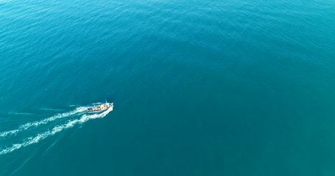 121 Aerial 4k cinematic  ,  fishing boat with fishermen preparing the  fishing nets for work