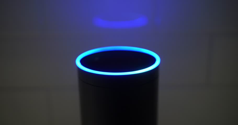 Circa February, 2018 - The blue ring atop an Amazon Alexa virtual assistant circles in a darkened kitchen.