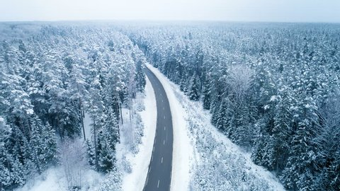 Truck Driving Winter Ice Road, Aerial View