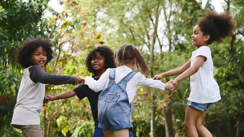 Group of children playing together in a park. Slow motion   Shutterstock HD Video #1007970289