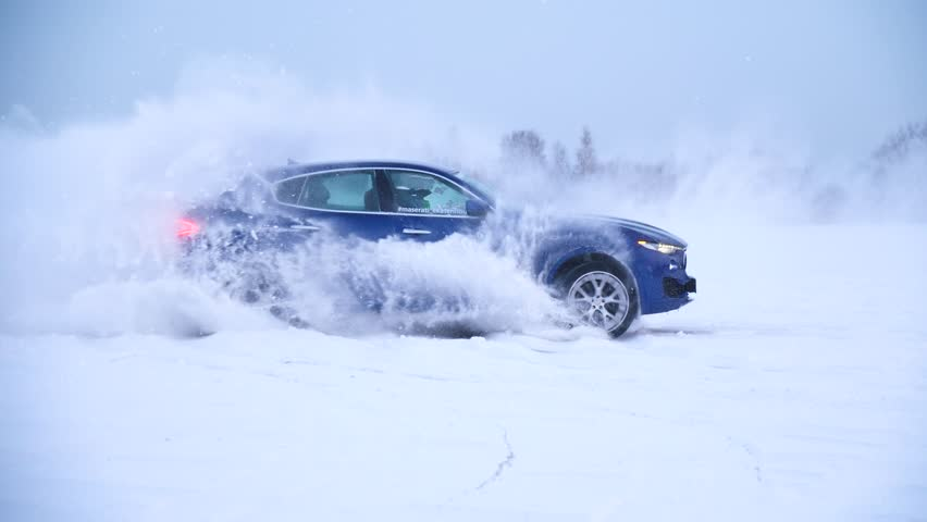 Sliding on an ice line. Snow drifting. DRIVING IN THE SNOW. Sport car racing on snow race track in winter. Driving a race car on a snowy road. | Shutterstock HD Video #1007984359