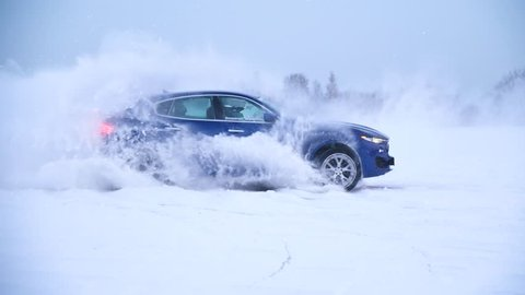 Sliding on an ice line. Snow drifting. DRIVING IN THE SNOW. Sport car racing on snow race track in winter. Driving a race car on a snowy road.