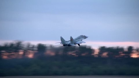 The rise of the military aircraft MIG 29 from the airfield, climb