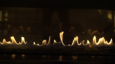 Fire flame Flames in a Modern Fireplace roaring gas burning indoor at night