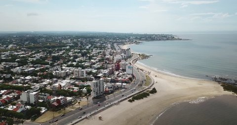 Aerial - Flying over beach and city coast in Montevideo - Uruguay
