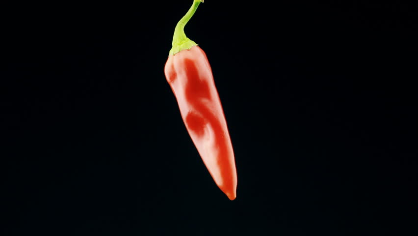 Red chili peppers, macro shot on black background.