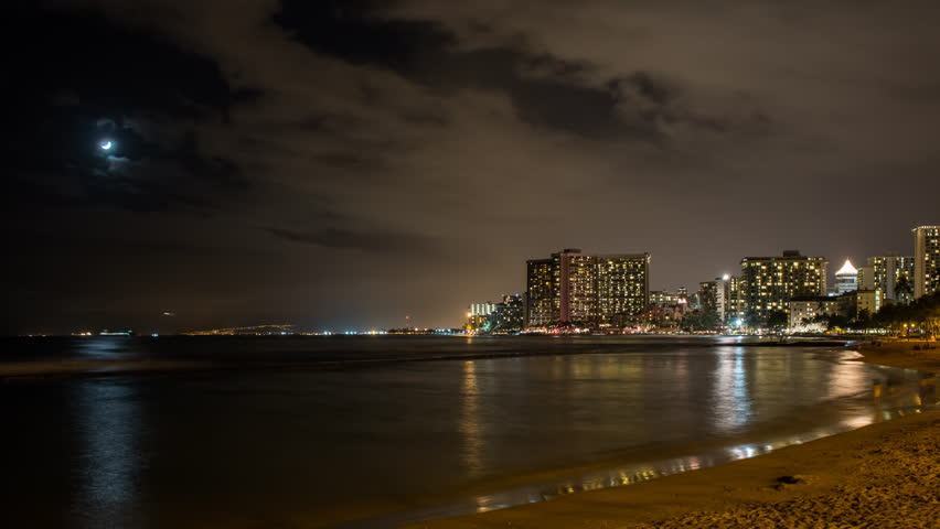 Zoom out time lapse of Waikiki beach at night with Honolulu airport in the background | Shutterstock HD Video #10081202